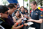David Coulthard signs autographs during the Red Bull Speed Street Kuala Lumpur, at the main shopping street Jalan Buit Bintang in Kuala Lumpur, Malaysia on 3rd April 2011. Photo by Victor Fraile / The Power of Sport Images for Red Bull