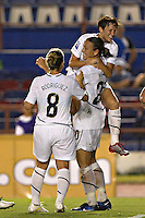 Amy Rodriguez (8), Abby Wambach (20) and Megan Rapinoe celebrate at the 2010 CONCACAF Women's World Cup Qualifying tournament held at Estadio Quintana Roo in Cancun, Mexico.