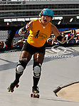A Gold Digger Roller Derby girl skates around the track before the Samsung Mobile 500 Sprint Cup race at Texas Motor Speedway in Fort Worth,Texas.