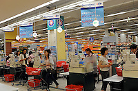 The check-out at a branch of the French retailer Carrefour in Sayama, Saitama Prefecture, Japan. Carrefour sold it's stores to Japanese Company EON in 2005. The Sayama store was virtually deserted on Wednesday evening..