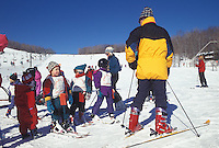 Stowe, skiing, Vermont, VT, Ski instructor giving instructions to children's classes at the Stowe Ski School at Spruce Mountain at Stowe Mountain Resort in Stowe in the snow in winter.