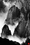 Huangshan, Anhui Province, China<br /> I always believed that Chinese master landscape painters had creative imaginations until I visited Huangshan and discovered that their paintings were quite faithful to reality. Huangshan, which means Yellow Mountain and is located in eastern China's Anhui Province, is famous for its countless jagged rock towers, beautiful wind sculpted pine trees, and seas of swirling clouds. Huangshan resembles a sumi painting more than a real place.