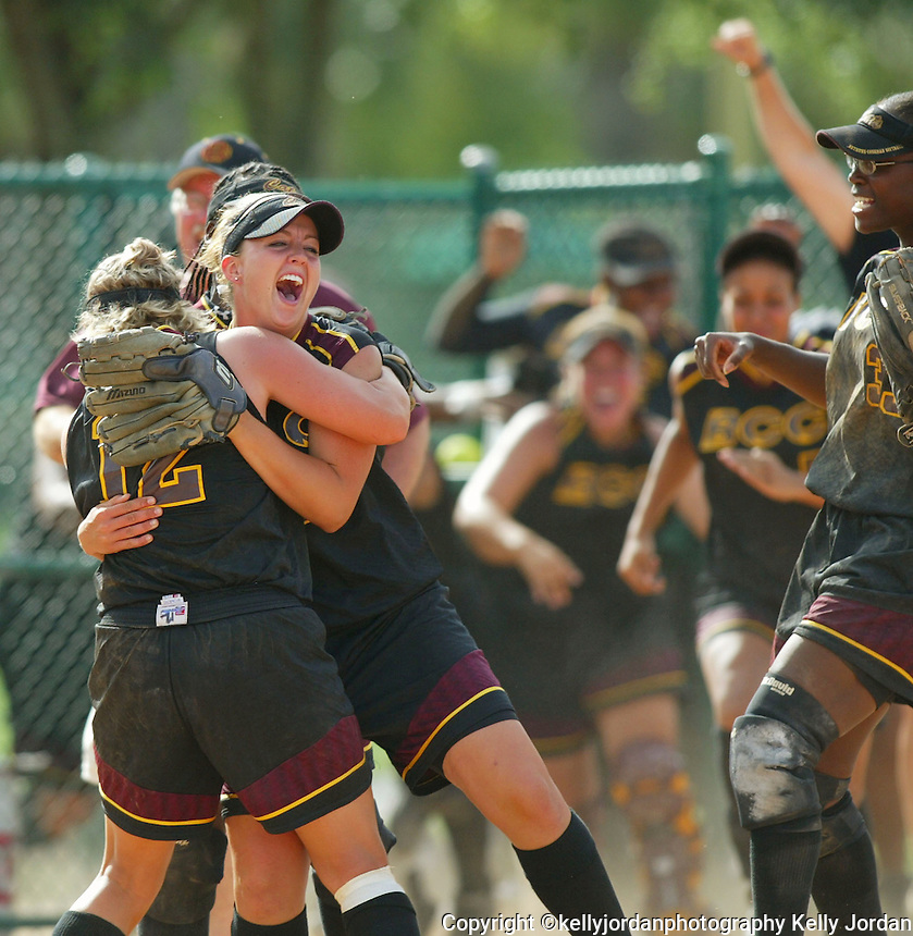 Bethune-Cokman College softball team's winning closing pitcher Katie Finn, (23), left, is hugged by fellow teammate, Krista Schile, (12), as they celebrate their MEAC conference championship at the Disney Wide World of Sports Cracker Jack Stadium Sunday May 2, 2004. The Lady Cats came from the losers bracket to win three games and take the championship against Delaware.(Kelly Jordan)