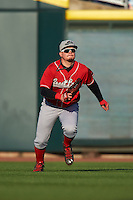 Great Lakes Loons outfielder Alex Verdugo (9) makes a play on a base hit during a game against the Dayton Dragons on May 21, 2015 at Fifth Third Field in Dayton, Ohio.  Great Lakes defeated Dayton 4-3.  (Mike Janes/Four Seam Images)