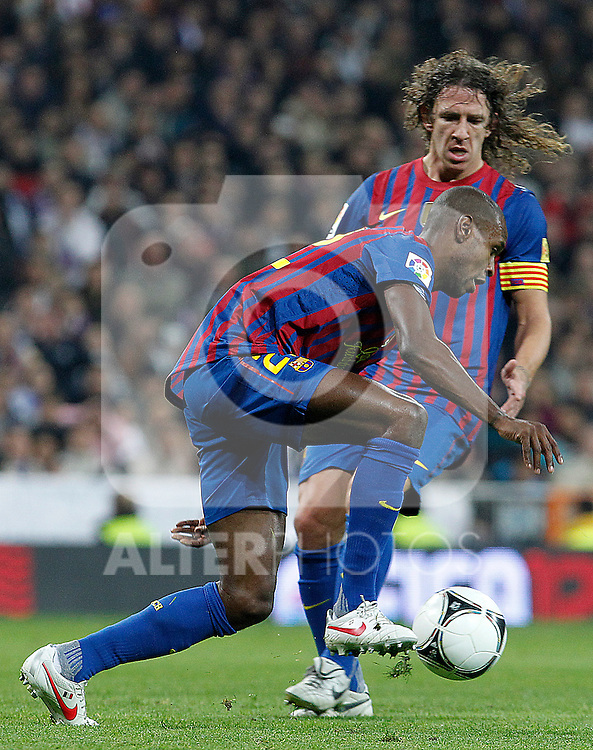 FC Barcelona's Eric Abidal (f) and Carles Puyol during Spanish King's Cup match.January 18,2011. (ALTERPHOTOS/Acero)