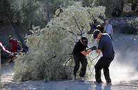 Pictured: Special forensics police officers move a tree after it was felled to make space for a further search by a disused building in a field in Kos, Greece. Saturday 01 October 2016<br /> Re: Police teams led by South Yorkshire Police, searching for missing toddler Ben Needham on the Greek island of Kos have moved to a new area in the field they are searching.<br /> Ben, from Sheffield, was 21 months old when he disappeared on 24 July 1991 during a family holiday.<br /> Digging has begun at a new site after a fresh line of inquiry suggested he could have been crushed by a digger.