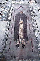 """Rome Colle Aventino, The Basilica of Saint Sabina lapide sepolcrale di Munio de Zavora<br /> General of the Dominicans who died in 1300, it is the most important in its rare type of mosaic tombstone. It is in the center of the main nave and, attributable to Jacopo Torriti or Fra Pasquale da Viterbo, testifies to the presence of the Cosmati in the embellishment works promoted by the Dominicans.<br /> The basilica of Santa Sabina all'Aventino is a Catholic place of worship in the historic center of Rome, located on the Aventine hill, in the territory of Rione XII Ripa. Built in the 5th century on the tomb of Santa Sabina, as well as one of the best preserved early Christian churches ever,<br /> <br /> The Basilica of Saint Sabina (Latin: Basilica Sanctae Sabinae, Italian: Basilica di Santa Sabina all'Aventino) is a historic church on the Aventine Hill in Rome, Italy. It is a titular minor basilica and mother church of the Roman Catholic Order of Preachers, better known as the Dominicans.<br /> <br /> Santa Sabina is the oldest extant Roman basilica in Rome that preserves its original colonnaded rectangular plan and architectural style. Its decorations have been restored to their original restrained design. Other basilicas, such as Santa Maria Maggiore, are often heavily and ornately decorated. Because of its simplicity, the Santa Sabina represents the crossover from a roofed Roman forum to the churches of Christendom. It is especially famous for its 5th-century carved wood doors, with a cycle of Christian scenes (18 now remaining) that is one of the earliest to survive.<br /> <br /> Santa Sabina is perched high above the Tiber to the north and the Circus Maximus to the east. It is next to the small public park of Giardino degli Aranci (""""Garden of Oranges""""), which has a scenic terrace overlooking Rome. It is a short distance from the headquarters of the Knights of Malta.<br /> History<br /> Santa Sabina was built by Peter of Illyria, a Dalmatian priest, between 422 and"""