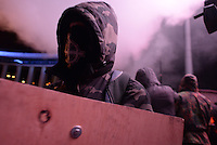 An hooded rioter seen during the  protest against new draconian law to ban protestsacross the country.  Kiev. Ukraine