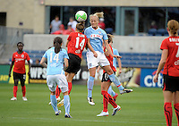 Chicago midfielder Katie Chapman (17) battles for a header with Atlanta's Carolyn Blank (14).  The Chicago Red Stars tied the Atlanta Beat 0-0 at Toyota Park in Bridgeview, IL on June 6, 2010.