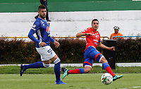 IPIALES- COLOMBIA,18-05-2019:Andrey Estupinan (Der.) jugador del Deportivo Pasto  disputa el balón con Matias de Los Santos (Izq.) jugador de Millonarios durante el tercer  partido de los cuadrangulares finales de la Liga Águila I 2019 jugado en el estadio Municipal de Ipiales de la ciudad de Ipiales. /Andrey Estupinan (R) player of Deportivo Pasto fights the ball  against of Matias de Los Santos (L) player of Millonarios  during the third match for the quarter finals B of the Liga Aguila I 2019 played at the Municipal de Ipiales stadium in Ipiales city. Photo: VizzorImage / Leonardo Castro / Contribuidor