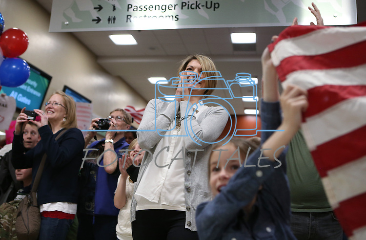 Alyssa Harrison reacts to seeing her husband, Lt. Nigel Harrison, as Nevada Army Guard soldiers arrive at the Reno-Tahoe International Airport in Reno, Nev., on Sunday, Feb. 16, 2014. About 300 supporters greeted the 1/168th General Support Battalion after a 10-month deployment in Afghanistan. (Las Vegas Review-Journal/Cathleen Allison)