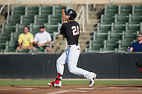 Louie Lechich (21) of the Kannapolis Intimidators follows through on his swing against the Hagerstown Suns at Intimidators Stadium on July 18, 2015 in Kannapolis, North Carolina.  The Intimidators defeated the Suns 1-0.  (Brian Westerholt/Four Seam Images)