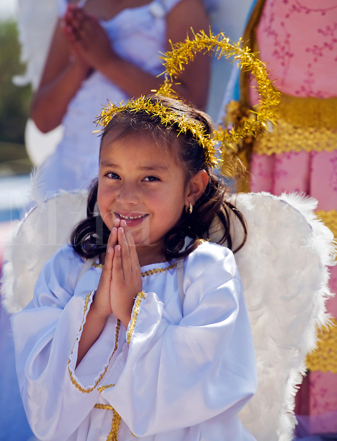 A young Mexican girl is dressed up as the VIRGIN OF GUADALUPE in the town of LOS RODRIGUEZ - GUANAJUATO, MEXICO