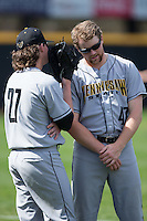 Jordan Hillyer (47) of the Kennesaw State Owls listens to teammate Will Lowman (27) prior to the game against the Winthrop Eagles at the Winthrop Ballpark on March 15, 2015 in Rock Hill, South Carolina.  The Eagles defeated the Owls 11-4.  (Brian Westerholt/Four Seam Images)