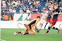 FOXOBOROUGH, MA - AUGUST 21: Przemyslaw Tyton #22 of FC Cincinnati saves a shot on goal during a game between FC Cincinnati and New England Revolution at Gillette Stadium on August 21, 2021 in Foxoborough, Massachusetts.