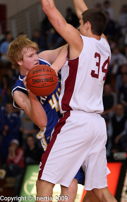 SIOUX FALLS, SD - FEBRUARY 5:  Danny Hughes #44 of O'Gorman runs into the smothering defense of Cody Larson #34 from Roosevelt in the first half of their game Thursday night at Roosevelt. (Photo by Dave Eggen/Inertia)