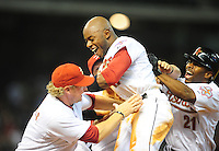 Apr. 30, 2011; Houston, TX, USA: Houston Astros batter (11) Jason Bourgeois celebrates with teammates after hitting a walk off single in the ninth inning against the Milwaukee Brewers at Minute Maid Park. The Astros defeated the Brewers 2-1. Mandatory Credit: Mark J. Rebilas-