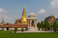 Bangkok, Thailand.  Grand Palace Compound.  Wat Phra Kaew, Temple of the Emerald Buddha, on Right.  Monument to Late King Bhumibol Adulyadej in Center Foreground.