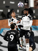 13th March 2021, Craven Cottage, London, England;  Fulhams Andre-Frank Zambo Anguissa wins a header during the English Premier League match between Fulham and Manchester City at Craven Cottage in London