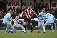 Frankie Curley of Hornchurch finds himself surrounded by opposition players - AFC Hornchurch vs Billericay Town - Ryman League Premier Division Football at The Stadium, Upminster Bridge, Essex - 09/04/12 - MANDATORY CREDIT: Gavin Ellis/TGSPHOTO - Self billing applies where appropriate - 0845 094 6026 - contact@tgsphoto.co.uk - NO UNPAID USE
