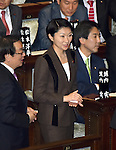 December 24, 2014, Tokyo, Japan - Yuko Obuchi, daughter of the late Prime Minister Keizo Obuchi, is on her way to cast her ballot in a parliamentary process to elect Japan's new leader during a special Diet session convened in Tokyo on Wednesday, December 24, 2014.   (Photo by Natsuki Sakai/AFLO)