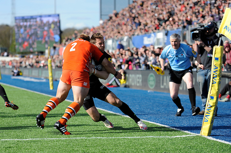 Chris Wyles of Saracens  forces his way past Tom Youngs of Leicester Tigers to score a try in the corner during the Aviva Premiership Rugby match between Saracens and Leicester Tigers at Allianz Park on Saturday 11th April 2015 (Photo by Rob Munro)