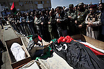 © Remi OCHLIK/IP3 -   Benghazi  March 20, 2011 - Libyan men morn the dead in front of the court house along the sea. - At least 84 people, most of them are civilians , and had been killed in the Ghadafi air strike the day before.