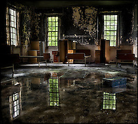 Reflections in a flooded ward of an abandoned mental asylum.