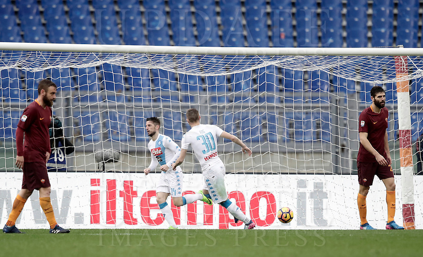 Napoli's Dries Mertens, second from left, celebrates with teammate Marko Rog, second from right, as Roma's Daniele De Rossi, left, and Federico Fazio react after scoring during the Serie A soccer match between Roma and Napoli at the Olympic stadium, 4 March 2017.<br /> UPDATE IMAGES PRESS/Isabella Bonotto