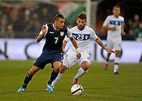 Danny Williams  (l, USA) vs. Antonio Nocerino (ITA), during the friendly match Italy against USA at the Stadium Luigi Ferraris at Genoa Italy on february the 29th, 2012.