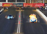 Feb 25, 2018; Chandler, AZ, USA; NHRA funny car driver John Force (right) explodes the body off his car on fire alongside Jonnie Lindberg during the Arizona Nationals at Wild Horse Pass Motorsports Park. Mandatory Credit: Mark J. Rebilas-USA TODAY Sports