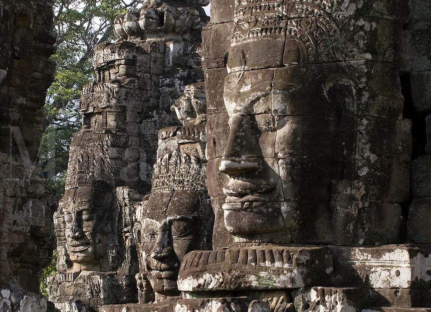 View of three face towers of The Bayon at Angkor Thom, the largest Khmer city ever built, are part of the Angkor Wat complex  -  Siem Reap, Cambodia...