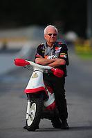 Jun. 19, 2011; Bristol, TN, USA: NHRA pro stock driver Warren Johnson during eliminations at the Thunder Valley Nationals at Bristol Dragway. Mandatory Credit: Mark J. Rebilas-