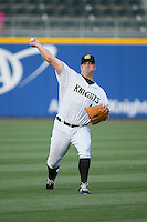 Charlotte Knights starting pitcher Brad Penny (46) warms up in the outfield prior to the game against the Norfolk Tides at BB&T BallPark on April 9, 2015 in Charlotte, North Carolina.  The Knights defeated the Tides 6-3.   (Brian Westerholt/Four Seam Images)