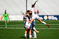 MONTCLAIR, NJ - OCTOBER 3: Ashley Hatch #33 of the Washington Spirit jumps on the backs of her teammates as they celebrate a goal by Kumi Yokoyama #17 of the Washington Spirit during a game between Washington Spirit and Sky Blue FC at MSU Soccer Park at Pittser Field on October 3, 2020 in Montclair, New Jersey.