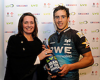 Matthew Morgan of Ospreys receives the Man of the Match award from Claire Jeromsen, LV= Head of Sponsorship after the LV= Cup second round match between Ospreys and Northampton Saints at Riverside Hardware Brewery Field, Bridgend (Photo by Rob Munro)