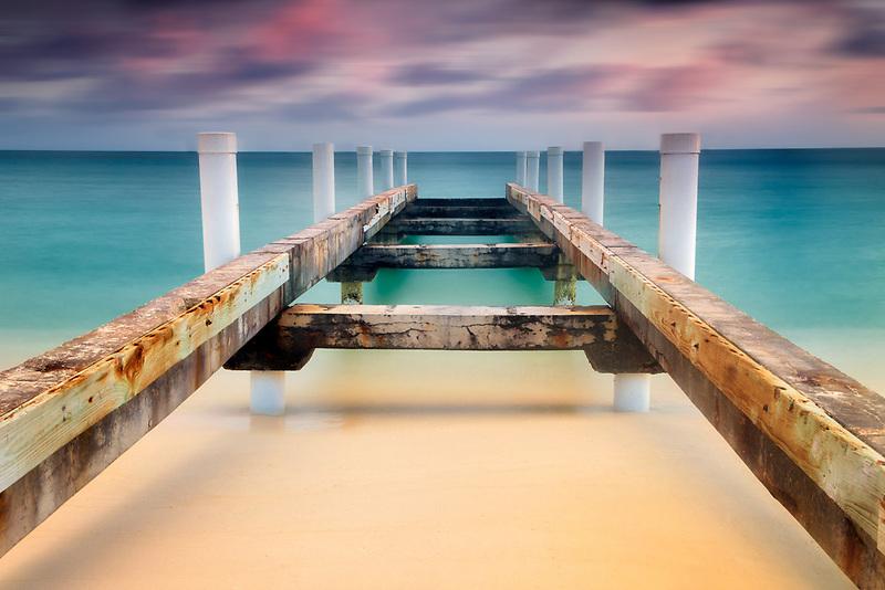 Dilapidated pier at sunrise. Providenciales, Caicos Islands