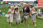 Middle aged women friends at Ladies Day, the Derby horse race. Epsom Down Surrey UK. 2012