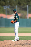 Oakland Athletics relief pitcher Calvin Coker (41) gets ready to deliver a pitch during an Instructional League game against the Chicago White Sox at Lew Wolff Training Complex on October 5, 2018 in Mesa, Arizona. (Zachary Lucy/Four Seam Images)