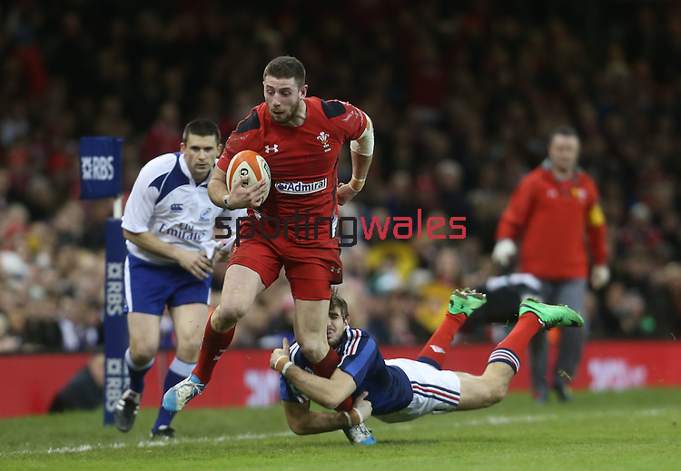 French wing Hugo Bonneval dives in to tackle Alex Cuthbert.<br /> RBS 6 Nations 2014<br /> Wales v France<br /> Millennium Stadium<br /> 21.02.14<br /> <br /> ©Steve Pope-SPORTINGWALES