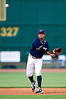 Christian Colon (4) of the Northwest Arkansas Naturals throws to first during a game against the San Antonio Missions at Arvest Ballpark on June 30, 2011 in Springdale, Arkansas. (David Welker / Four Seam Images)