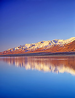 Sunrise on Steens Mountains with reflection in Mann Lake. Oregon.