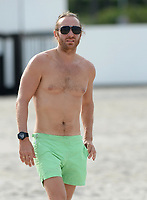 MIAMI BEACH, FL - OCTOBER 08: Shirtless David Guetta With unidentified Woman on Miami Beach.  The married French house music producer and disc jockey is caught with this knock out babe and its not Cathy, his wife of 20 years on October 8, 2013 in Miami Beach, Florida <br /> <br /> <br /> People:  David Guetta