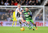 Leon Britton of Swansea City chased by Darren Fletcher of West Bromwich Albion during the Barclays Premier League match between West Bromwich Albion and Swansea City at The Hawthorns on the 2nd of February 2016