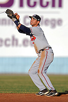 Rome Braves shortstop Jose Peraza #4 leaps for the ball during a game against the Asheville Tourists at McCormick Field on May 23, 2013 in Asheville, North Carolina. The Braves won the game 6-1. (Tony Farlow/Four Seam Images).