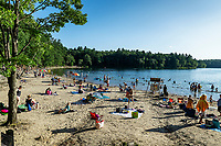 Walden Pond beach is a popular swimming destination, Concord, Massachusetts, USA.