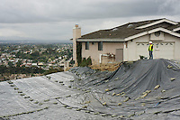 Dan McLorn of Quantum Risk Managment looked over the site of the October landslide in La Jolla  January 21, 2008.  Crews covered the hillside with plastic and firehouses connected to water pumps crisscrossed the hillside as workers braced for rain. Workers appeared to be taking every precaution in the wake of new movement that occured at the site on Thursday last.