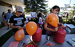 Teen volunteers Brad Shepherd, 13, and Mardison Bombard, 14, work at the Summer Reading Program Pancake Breakfast Kick-Off at the Carson City Library, in Carson City, Nev., on Saturday, June 8, 2013. <br /> Photo by Cathleen Allison