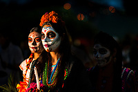 Young Mexican women, dressed as La Catrina, a Mexican pop culture icon representing the Death, take part in the Day of the Dead parade in Oaxaca, Mexico, 31 October 2019. Day of the Dead (Día de Muertos), a religious holiday combining the death veneration rituals of Pre-Hispanic cultures with the Catholic practice, is widely celebrated throughout all of Mexico. Based on the belief that the souls of the departed may come back to this world on that day, people gather together while either praying or joyfully eating, drinking, and playing music, to remember friends or family members who have died and to support their souls on the spiritual journey.