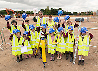 Children from Abbey Primary School don hard hads and Hi-viz to survey the site of their new £4 Million School bing built by Nottingham-based Kier Construction. Pictured with the children is Kier's Richard Charman and School Head Kim Wakefield
